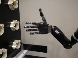 Using mind control, a woman with quadriplegia moves robot arm and hand in. (Credit: Journal of Neural Engineering/IOP Publishing)