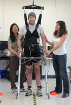 A man whose legs had been paralyzed for five years walks along a 12-foot course using UCI-developed technology that lets the brain bypass the spinal cord to send messages to the legs. (credit: courtesy of UCI's Brain Computer Interface Lab)