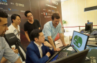 Carnegie Mellon University professor Tuomas Sandholm talks to Kai-Fu Lee, head of Sinovation Ventures, a Chinese venture capital firm, as Lee plays poker against Lengpudashi AI (credit: Sinovation Ventures)