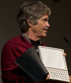 Alan Kay with Dynabook (Wikimedia Commons)