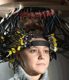 Research participant Britt Gott wears a cap used to image the brain via diffuse optical tomography (DOT)