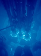 Cherenkov radiation (credit: Wikimedia Commons)
