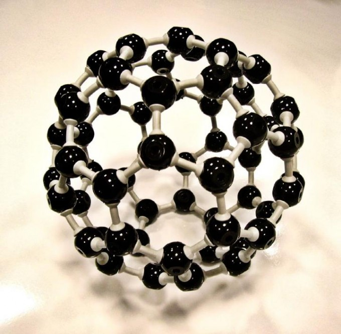 Gevorg Grigoryan, an assistant professor of computer science at Dartmouth College, and his collaborators have created an artificial protein that self-organizes into a new material -- an atomically periodic lattice of buckminster fullerene molecules, or buckyball, a sphere-like molecule composed of 60 carbon atoms shaped like a soccer ball. (credit: St Stev via Foter.com / CC BY-NC-ND)