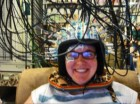 Experimental setup showing the event-related optical signal (EROS) equipment, with source and detector fibers traveling to and from the head attached with a modified motorcycle helmet (credit: Kyle E. Mathewson et al./Journal of Cognitive Neuroscience)