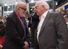 de these new siblings of electrons and quarks.<br /> François Englert and Peter Higgs meet for the first time,<br /> at CERN when the discovery of a Higgs particle was<br /> announced to the world on 4 July 2012.<br /> Photo: CERN, htt