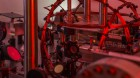 The experiment, featuring the small red glow of a BEC trapped in infrared laser beams. (credit: Stuart Hay, ANU)