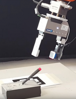 A GelSight sensor attached to a robot's gripper enables the robot to determine precisely where it has grasped a small screwdriver, removing it from and inserting it back into a slot, even when the gripper screens the screwdriver from the robot's camera. (credit: Robot Locomotion Group at MIT)