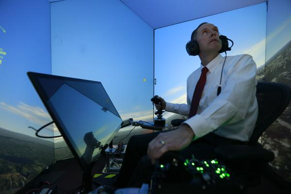 Retired United States Air Force Colonel Gene Lee, in a flight simulator, takes part in simulated air combat versus artificial intelligence technology developed by a team comprised of industry, US Air Force and University of Cincinnati representatives. (credit: Lisa Ventre, University of Cincinnati Distribution A: Approved for public release; distribution unlimited. 88ABW Cleared 05/02/2016; 88ABW-2016-2270)