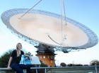 Jacinta Delhaize with CSIRO's Parkes Radio Telescope during one of her data collecting trips (credit: Anita Redfern Photography)