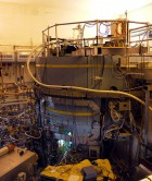 The Alcator C-Mod tokamak experiment at the MIT Plasma Science and Fusion Center. Overview showing the device itself (under concrete shielding) and diagnostics in surrounding bay. (Credit:  Wikimedia Commons)