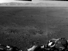 "First full-resolution (1024 by 1024 pixels) long-range image of the Martian surface from one of the Navigation cameras on NASA's Curiosity rover, which are located on the rover's ""head"" or mast. The rim of Gale Crater can be seen in the distance beyond the pebbly ground. The topography of the rim is very mountainous due to erosion. The ground seen in the middle shows low-relief scarps and plains. The foreground shows two distinct zones of excavation likely carved out by blasts from the rover's descent stage thrusters. (Credit: NASA/JPL-Caltech)"
