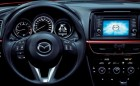 Mazda 2015 dashboard. Phone calls can be made or received via Bluetooth on the steering wheel and the display has multiple screens for radio, Sirius XM, GPS, and phone directory. (credit: Landmark MAZDA)