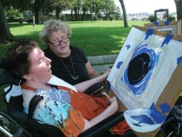 Nancy Worthen is doing art therapy with her daughter, Maggie, who was minimally conscious. (credit: Nancy Worthen)