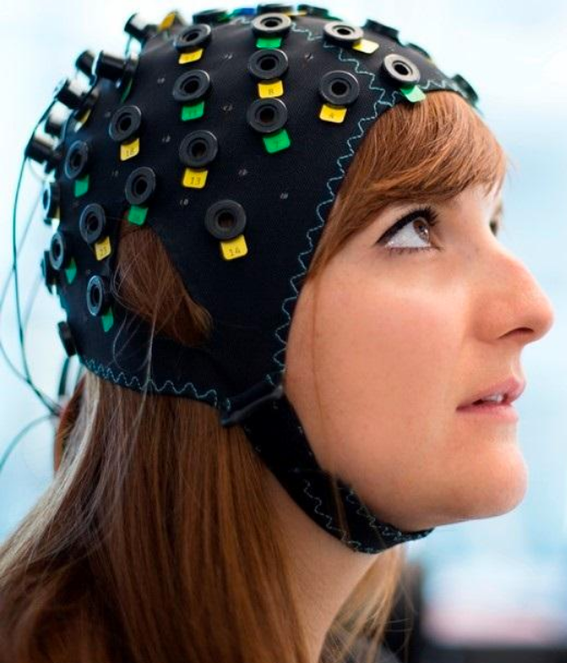 "NIRS/EEG brain computer interface system for sensing ""yes"" or ""no"" thoughts, shown on a model (credit: Wyss Center for Bio and Neuroengineering)"