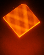 "In this image, laser light enters a synthetic diamond from a facet at its corner and bounces around inside the diamond until its energy is exhausted. This excites ""nitrogen vacancies"" that can be used to measure magnetic fields. (Credit: H. Clevenson/MIT Lincoln Laboratory)"