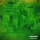 "High magnification image of the new tunable dielectric material, taken with Cornell's scanning transmission electron microscope. The atomic structure resembles a brick wall in which the horizontal and vertical lines, the ""mortar,"" are believed key to the performance of the material. (Credit: Ye Zhu/Muller group)"
