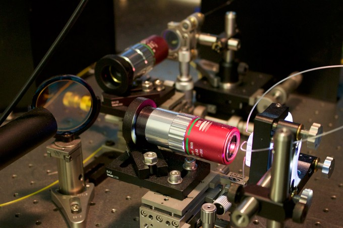 The microscope uses specially designed optics that boost image clarity and slows them enough to be detected and digitized at a rate of 36 million images per second. It then uses deep learning to distinguish cancer cells from healthy white blood cells. (credit: Tunde Akinloye/CNSI)
