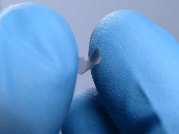 Even though they are less than 100 nanometers thick, the researchers' plates are strong enough to be picked up by hand and retain their shape after being bent and squeezed. (credit: University of Pennsylvania)