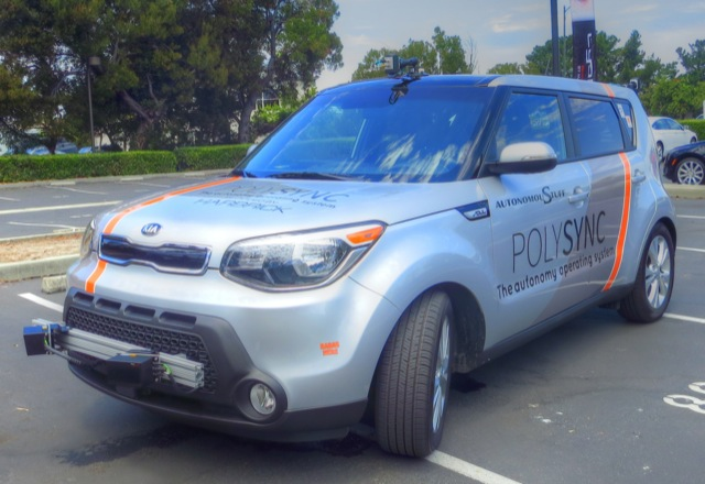 A demonstrator car with two Lidar laser sensors hanging on the front bumper, five radar sensors hiding behind the fenders, and two optical sensors with 360-degree fields of view on the roof. Click image for a larger view. (Credit: Harbrick)
