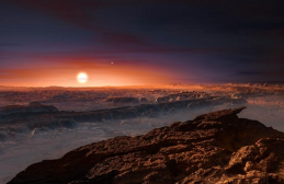 Artist's impression shows a view of the surface of the planet Proxima b orbiting the red dwarf star Proxima Centauri, the closest star to the Solar System. The double star Alpha Centauri AB also appears in the image to the upper-right of the star Proxima. (credit: ESO/M. Kornmesser)