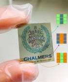 Researchers at Chalmers University of Technology have developed the basis for a new electronic 'paper.' Chalmers' logotype shows how the RGB pixels can reproduce color images. The magnification shows which pixels are activated to create the image. (credit: Kunli Xiong)