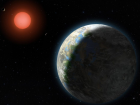 A planet with clouds and surface water orbits a red dwarf star in this artist's conception of the Gliese 581 star system.