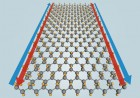 Adding fluorine atoms (yellow) to a single layer of tin atoms (grey) should allow a predicted new material, stanene, to conduct electricity perfectly along its edges (blue and red arrows) at temperatures up to 100 degrees Celsius (212 Fahrenheit). (Yong Xu/Tsinghua University; Greg Stewart/SLAC)