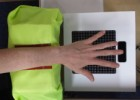 University of Sussex researchers used a system called UltraHaptics to stimulate areas of the hand to evoke different emotions. A soft structure was used to keep the hand position steady. (credit: SCHI Lab, University of Sussex)