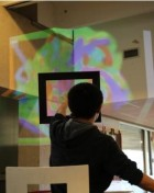 intangibleCanvas uses the ZeroTouch sensor as a precision free-air interactive input modality, allowing users to reach through the sensor and paint on a projected screen (credit: Interface Ecology Lab/Texas A&M)