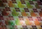 A silicon wafer containing the photonic-electronic microchips designed by the research team, which includes scientists from CU-Boulder, MIT, Micron and UC Berkeley. Introducing photonics into electronic microprocessors could extend Moore's Law well into the future. Courtesy of Milos Popovic.
