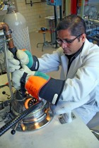 Scientist Arjun Pathak arc melts material in preparation for producing a new type of magnet (credit: Ames Laboratory)