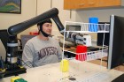 Research subjects at the University of Minnesota fitted with a specialized noninvasive brain cap were able to move the robotic arm just by imagining moving their own arms (credit: College of Science and Engineering)