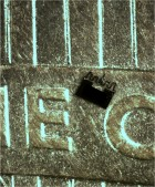"This image shows a ""microforce-sensing mobile microrobot"" juxtaposed against a U.S. penny. The device is being developed at Purdue University  (Credit: Purdue University)"