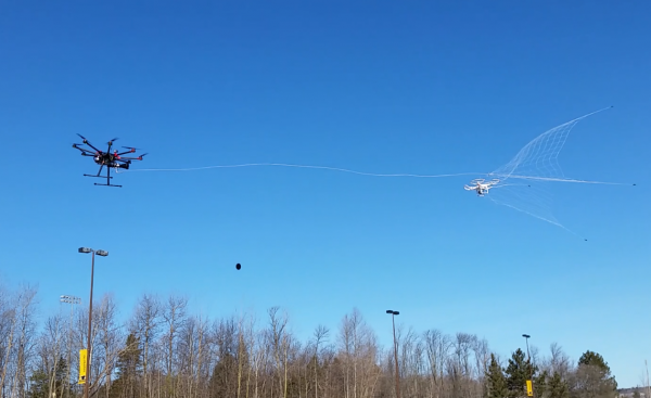 Mo Rastgaar's drone catcher speeds toward a rogue drone. (credit: Michigan Technological University)