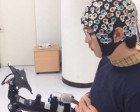 A volunteer calibrating the exoskeleton brain-computer interface (credit: (c) Korea University/TU Berlin)