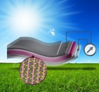 Illustration shows the layered structure of the new device, starting with a flexible layer of graphene, a one-atom-thick carbon material. A layer of polymer is bonded to that, and then a layer of zinc-oxide nano wires (shown in magenta), and finally a layer of a material that can extract energy from sunlight, such as quantum dots or a polymer-based material. (Credit: MIT)