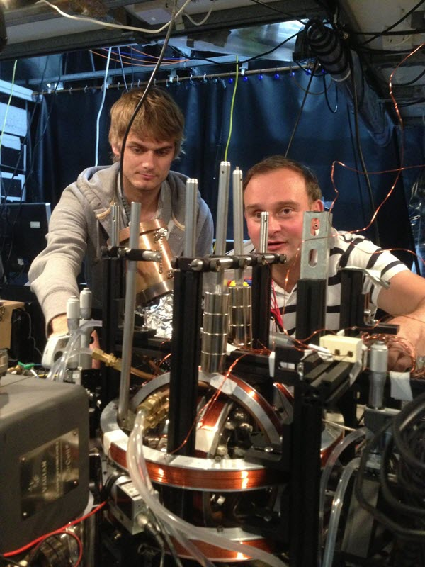 Winfried Hensinger (right) and Dr. Seb Weidt are freezing individual atoms using microwaves (credit: University of Sussex)