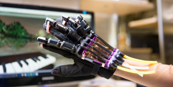 "Prototype of haptic VR glove, using soft robotic ""muscles"" to provide realistic tactile feedback for VR users (credit: Jacobs School of Engineering/UC San Diego)"