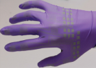 Inkjet-functionalized nitrile glove with arrays of electronic strain gauges, intricate wiring, and contact pads (credit: John William Boley et al./Advanced Materials)