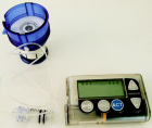 Insulin pump, showing an infusion set loaded into spring-loaded insertion device. A reservoir is attached to the infusion set (shown here removed from the pump).(Credit: Jacopo Werther/Wikimedia Commons)