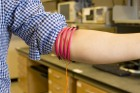 This is a prototype of the magnetic field human body communication, developed in Mercier's Energy-Efficient Microsystems Lab at UC San Diego, consists of magnetic-field-generating coils wrapped around three parts of the body, including the head, arm and leg. (credit: Jacobs School of Engineering, UC San Diego)
