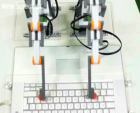 robot arms on keyboard