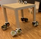 Movable table with Roombot feet (credit: EPFL)