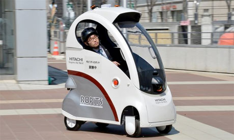 A Japanese robot car that drives itself on sidewalks and footpaths ...