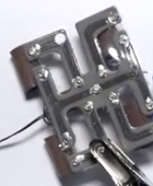A self-healing material that spontaneously repairs itself in real time from extreme mechanical damage, such as holes cut in it multiple times. New pathways are formed instantly and autonomously to keep this circuit functioning and the device moving. (credit: Carnegie Mellon University College of Engineering)