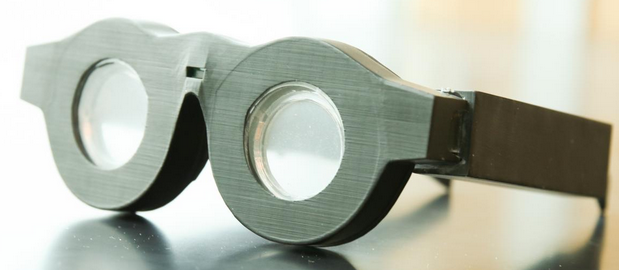 Early prototype of 'smart glasses' with liquid-based lenses that can automatically adjust the focus on what a person is seeing, whether it is far away or close up. The lenses are placed in battery-powered frames that can automatically adjust the focal length of the lenses based on what the wearer is looking at. Researchers expect to have smaller, lighter frames with the technology in as early as three years. (credit: Dan Hixson/University of Utah College of Engineering)