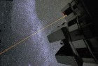 A space laser (adapted from a photograph of the Laser Guide Star adaptive optics system used on a telescope in Chile; credit: European Southern Observatory)