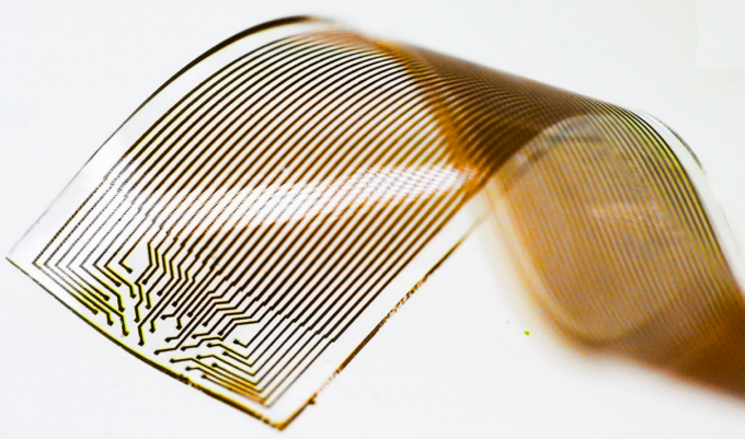 Photo of a new soft, elastic, high-density 32-electrode grid for long-term, stable neural recording and treatment of neurological disorders. It's based on a novel elastic material that's biocompatible and retains high electrical conductivity, even when stretched to double its original length. The 32 electrodes shown here are each 50 micrometers wide and located at a distance of 200 micrometers from each other. The fabrication procedure allows 32 electrodes to be placed onto a very small surface. The electrode grid is 3.2 millimeters wide and 80 micrometers thick. (credit: Thor Balkhed)