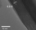 "A high-resolution transmission electron microscope image of layered, crystalline tungsten oxide dihydrate acts as a better supercapacitor than plain tungsten oxide (without the water layer). The ""stripes"" are individual layers of atoms separated by atomically thin water layers. (credit: James B. Mitchell et al./Chemistry of Materials)"